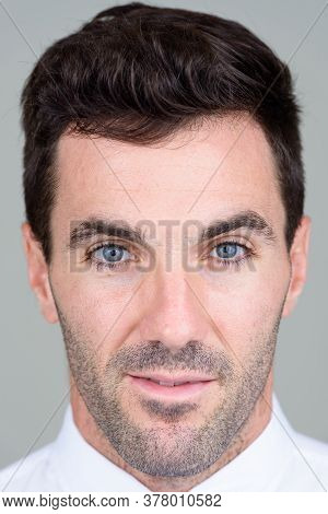 Face Of Handsome Hispanic Businessman With Beard Stubble