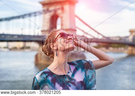Young Woman Looking Up During Sightseeing In Sunrise Budapest, Hungary