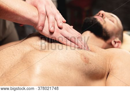 A Close-up Male Masseur Does A Sports Massage Of The Pectoral Muscle To The Client Athlete In A Prof