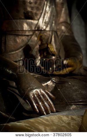 Buddha`s hand. Golden Buddha statue in Tibetan Monastery. India Ladakh Hemis Monastery poster
