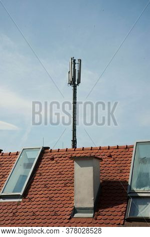 Mobile Phone Mast And Antennas On The Roof Of A Building In The City