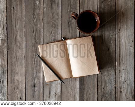 Office Desk With Blank Screen Smartphone, Pen, Notebook And Coffee Cup On Wood Table.top View With C