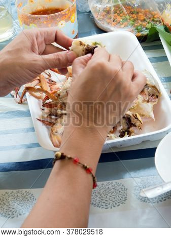 She's Peeling The Boiled Crab's Shell On The Foam Tray