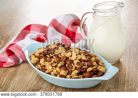 Checkered Napkin, Pitcher With Yogurt, Cereal Grains Breakfast With Chocolate And Caramel In Blue Gl