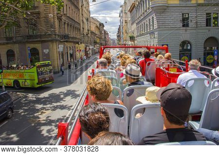 Budapest, Hungary- July 20, 2017: Tourists In A Double-decker Bus Hop-on-hop-off Ride Through The St