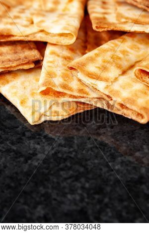 Fresh Crispy Biscuits Stacked On Black Marble. Freshly Baked Cookies. Selective Soft Focus With Copy