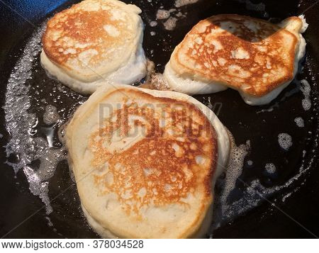 Pancakes Cooking In Cast Iron Skillet