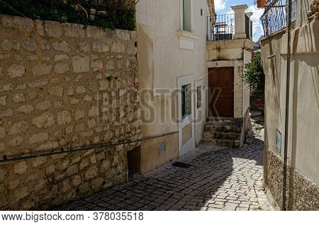 Alley Of An Ancient Sicilian Town With A Splendid Stone Road