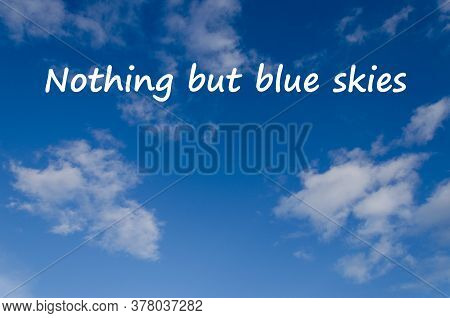 An Inspirational And Motivational Photograph Of A Blue Sky With A Few Wispy White Clouds. In Text, I