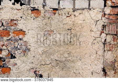Grey-brick Background Brick Wall Smeared With Cement.