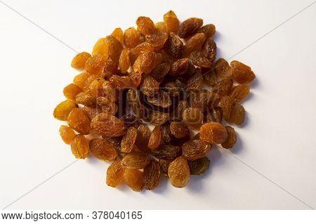 A Top Shot Of Dry Fruit Raisins Seedless Kishmish On White Background