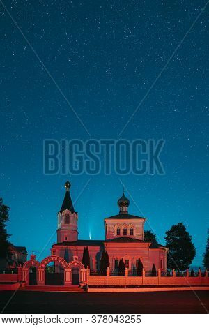 Korma Village, Dobrush District, Belarus. Comet Neowise C2020f3 In Night Starry Sky Above St. John T