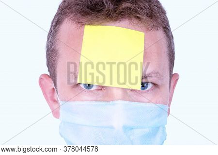 Adult Man With A Blank Yellow Sticky Reminder Note Attached To His Forehead. A Reminder Concept Of W