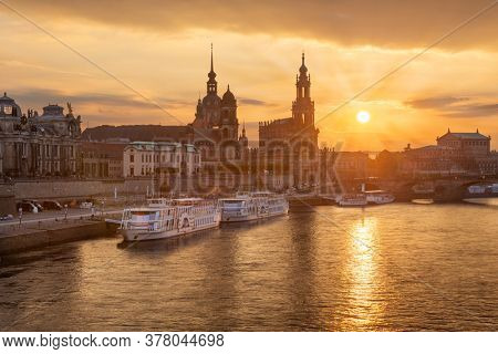 Dresden, Germany cityscape over the Elbe River at sunset.