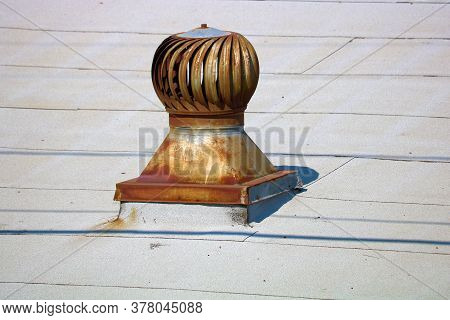 Antique Rusty Wind Driven Roof Turbine Vent That Sucks Hot Air From The Attic Which Was Popular In T