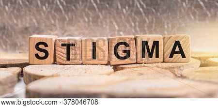 Wooden Blocks With The Word Stigma. Business And Finance Concept.