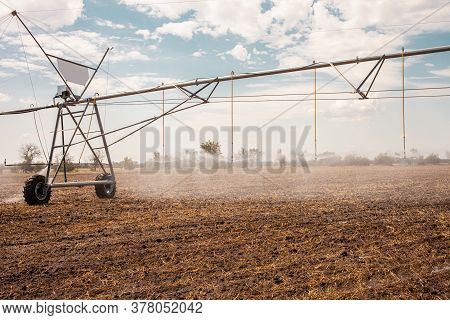 Moved Irrigation System On A Farmers Field. Field Irrigation
