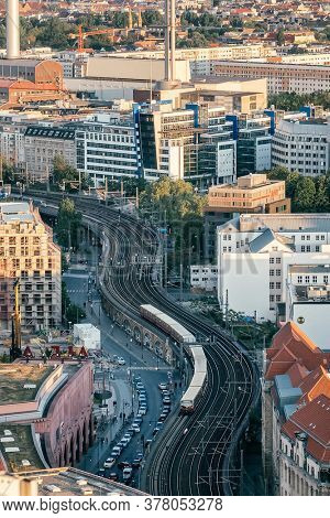 Berlin, Germany - May 18, 2019: Berlin cityscape with Berliner railway station and train. Top view of the city train runs on the tracks