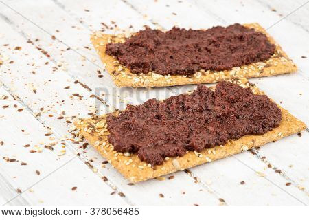 Sandwiches With Olive Paste On Gray Wooden Background.
