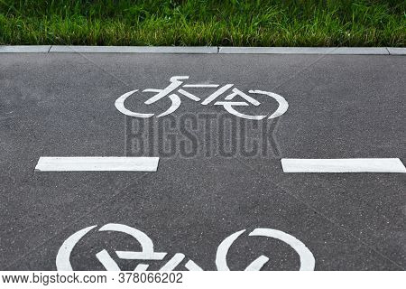 Bicycle Track Symbols On The Asphalt In A Park. Bicycle Signs On The Bicycle Way. Healthy Lifestyle