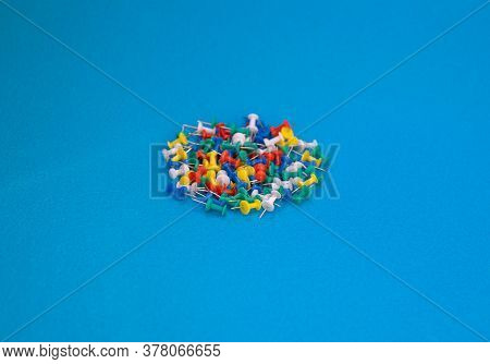 Multicolor Push Pins. A Great View Of Multicolored Push Pins Against A Blue Background