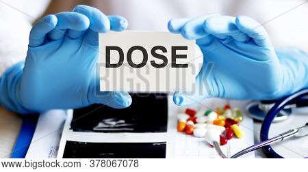 Text Dose Write On A Medicine Card. Medical Concept With A Stethoscope And Pills