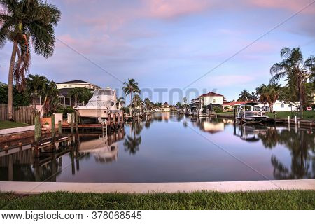 Sunrise Over A Waterway Leading To The Ocean Near Vanderbilt Beach In Naples, Florida.
