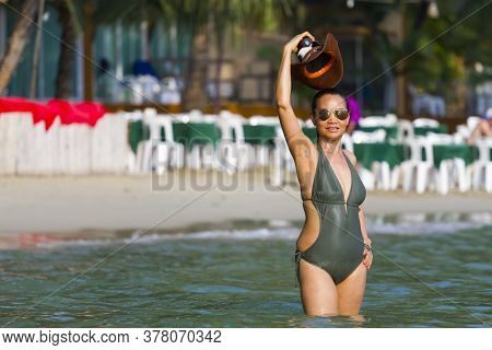 Woman With Swimsuit Stand Happy At Beach Koh Chang Thailand. Koh Chang Is Located In The Eastern Gul