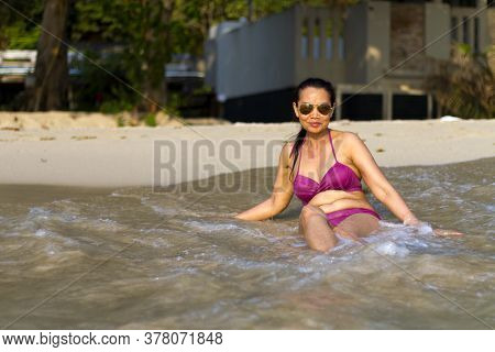 Woman In Bikini Pretty Sit Happy With Wave On Beach At Beach Koh Chang Thailand. Koh Chang Is Locate