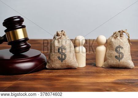 The Concept Of The Division Of Property In Business Between Owners Next To The Judge Hammer.