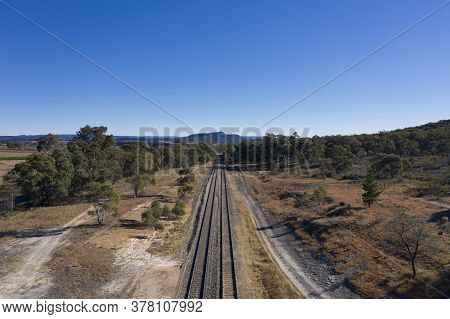Railway Tracks Heading Into The Australian Outback