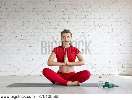 A Young Girl Is Engaged In Yoga. Lotus Position, Meditation And Calmness. Front View.