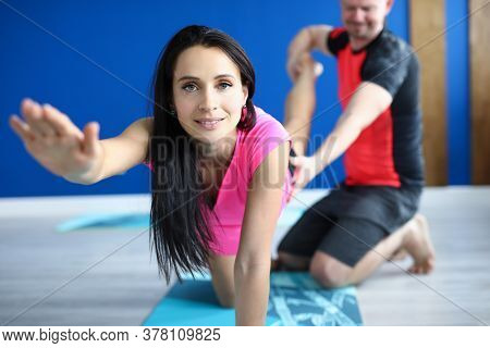 Individual Training With Fitness Trainer. Beautiful Woman In Sportswear Kneel On Rug In Gym And Do E