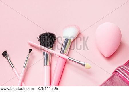 Top View Of Bright Pink Decorative Cosmetics Tools And Accessories For Professional Make Up And Visa