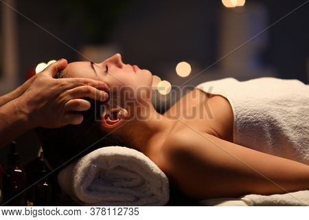 Woman Lay On Couch On Her Back With Closed Eyes And Enjoy. Man Make Relaxing And Therapeutic Head Ma