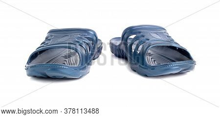 Pair Of Cheap Durable Blue Rubber Slippers Isolated On White Background.