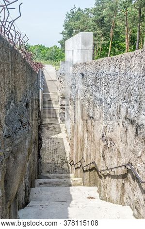 Belzec, Poland - June 12, 2020: Under The Ground Passage Built In Place Of Former Sluice Into The Ga