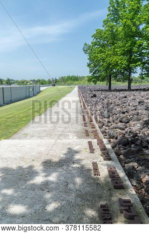 Belzec, Poland - June 12, 2020: Alley With City Names Inscription In Yiddish And Polish Language At