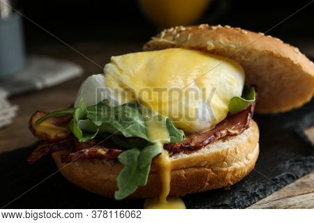 Delicious Egg Benedict Served On Slate Board, Closeup