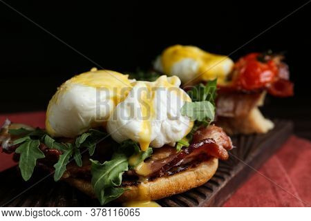Delicious Eggs Benedict Served On Wooden Board, Closeup