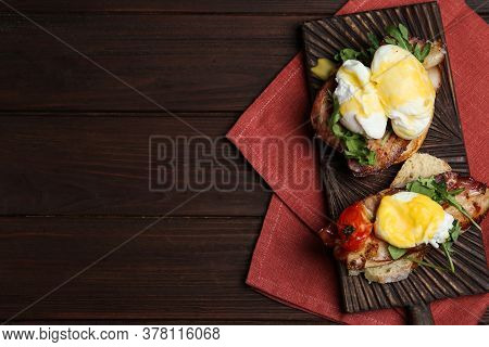 Delicious Eggs Benedict Served On Wooden Table, Flat Lay. Space For Text