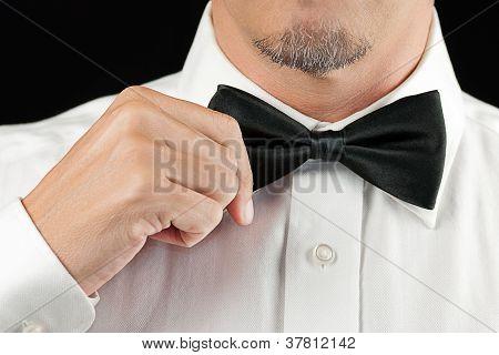 Man In Tux Straightens Bowtie, One Hand