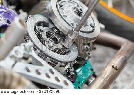 Mechanic Adjust Automatic Clutch Of Motorcycle.  (part Of An Engine That Controls The Power Transiti
