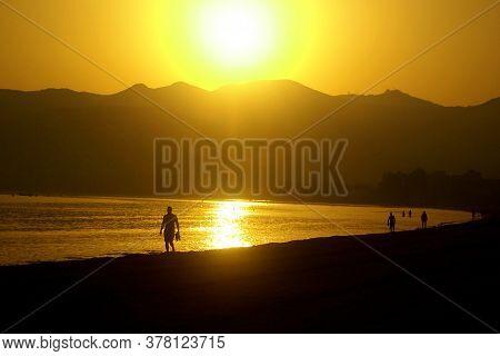 Beautiful View From Beach To The Orange Daybreak Sea