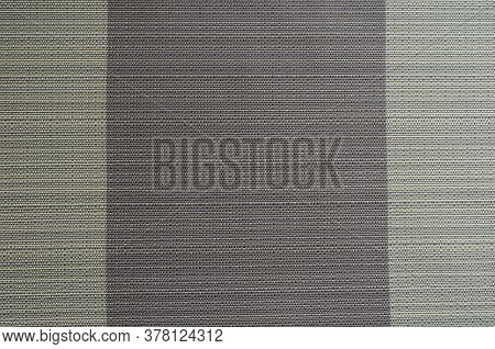 Abstract Background From Intertwined Beige And Purple Threads. Texture Of Synthetic Thread In Beige