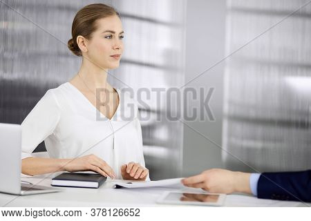 Business People Discussing Something While Sitting In Office. Focus At Businesswoman While Talking T