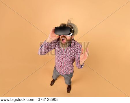 Virtual Reality Glasses. Scared Man In Virtual Reality Headset. 3d Goggles. Vr. Future Technology Co