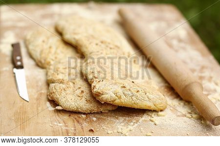 Two Ciabatta Bread Loaf Fresh Bake Close Up Photo On Kitchen Board