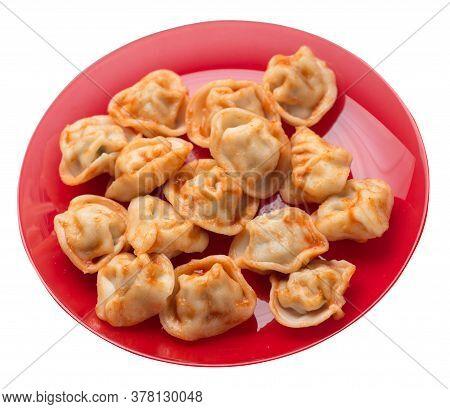 Dumplings On A Plate Isolated On White Background. Dumplings In Tomato Sauce. Dumplings Top View