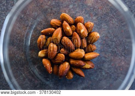 Simple Food Ingredients Concept, Salted Roasted Almonds In Clear Bowl